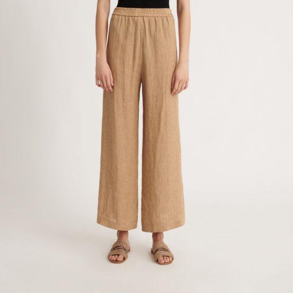 Бежеві льняні штани на резинці